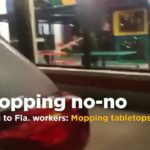 Burger King employee filmed cleaning tables with mop